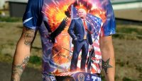 A Donald Trump supporter wears a colourful shirt showing his support. Photo by JASON CONNOLLY/AFP/Getty Images.