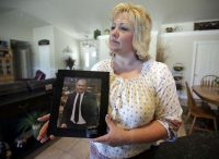 Laurie Holt holds a photograph of her son, Joshua Holt, at her home in Riverton, Utah. (Rick Bowmer/Associated Press)