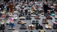 Shoes representing protesters at the climate talks summit in Paris last year. Credit Andre Larsson/NurPhoto, via Getty Images