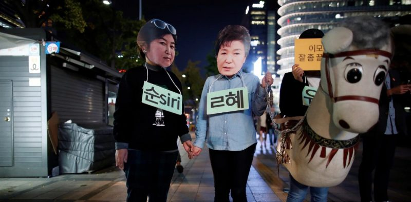 Protesters wearing cut-outs of South Korean President Park Geun-hye and Choi Soon-sil attend a protest denouncing the president. Kim Hong-Ji/Reuters