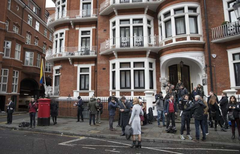 Journalists on Monday outside the Ecuadorian Embassy in London, where Julian Assange, founder of WikiLeaks, has been in exile. Rex Features, via Associated Press