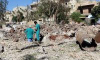 Locals inspect the area around the Sahra hospital in Aleppo after a barrel bomb strike by Syrian government forces in October. Photograph: Anadolu Agency/Getty Images