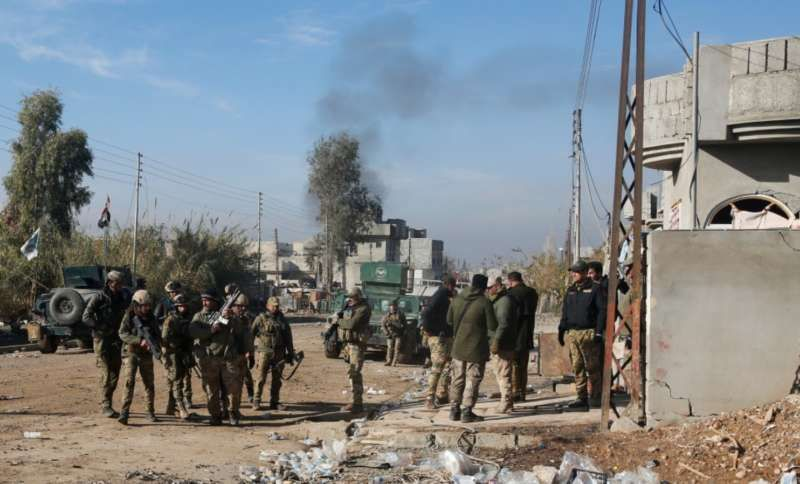 Iraqi rapid response forces gather during a fight with Islamic State militants in Intisar district of eastern Mosul on Dec. 22, 2016. (Reuters/Khalid al Mousily)
