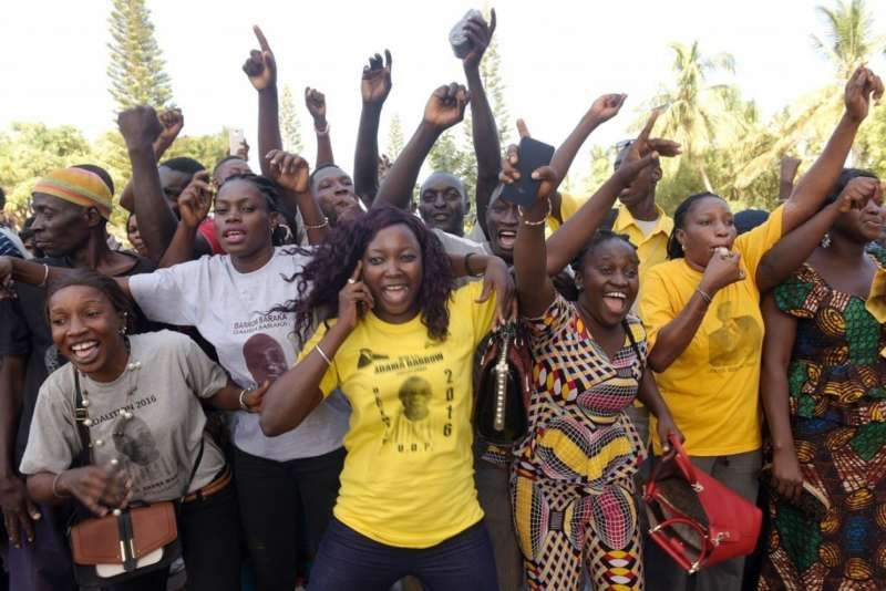 Supporters celebrate after Gambian opposition leader Ousainou Darboe, who had been jailed for taking part in a protest, was freed on bail with 18 others on Dec. 5 in Banjul, days after a shock opposition election win. (Seyllouseyllou/Agence France-Presse via Getty Images)
