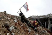 Syrian army soldiers during a battle this month with rebel fighters east of Aleppo. Hassan Ammar/Associated Press