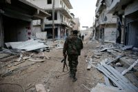 Syrian government soldiers in Aleppo on Saturday. Hassan Ammar/Associated Press