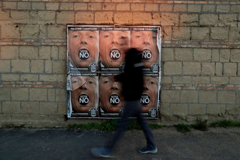 Posters in Rome showing Italian prime minister, Matteo Renzi, and promoting a no vote for the Dec. 4 constitutional referendum. Gregorio Borgia/Associated Press