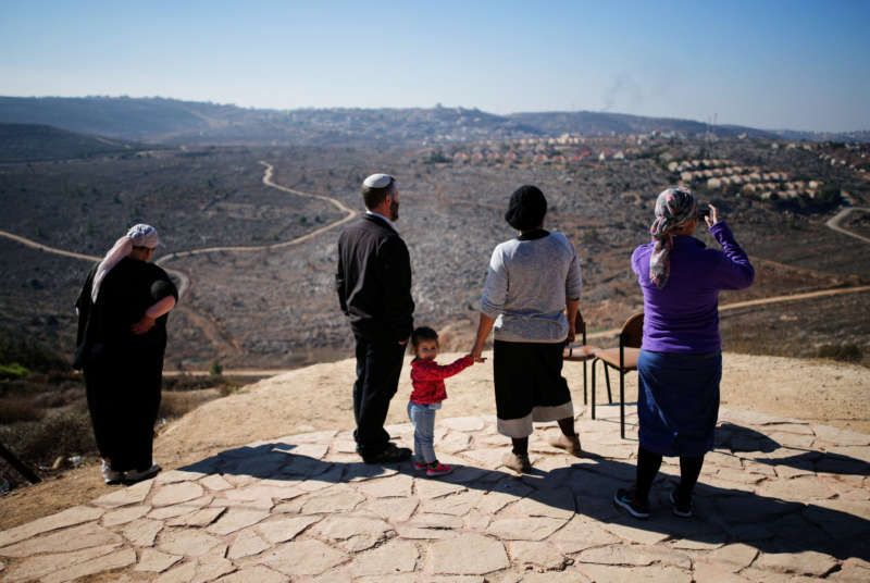 An Israeli family in the Jewish settlement Amona in the West Bank this month. Credit Amir Cohen/Reuters