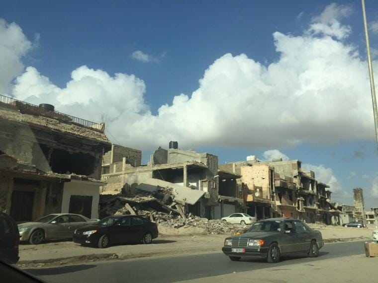 Buildings destroyed in bouts of fighting line a road in Benghazi, 19 July 2016. CRISIS GROUP/Claudia Gazzini