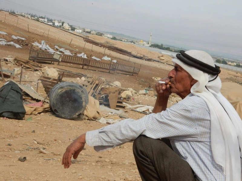 Abu Rasmi Ayyub amid the ruins of his village, al-Hammeh, demolished by the Israeli army on September 27, 2016