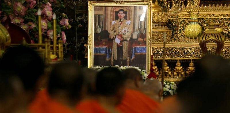 Buddhist monks pray in front of a picture of Thailand's new king at Wat Pho temple in Bangkok on December 1. Jorge Silva/Reuters