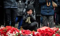 Mourners at the site of explosions near a football stadium in Istanbul that killed 44 people on Tuesday. Photograph: Ozan Kose/AFP/Getty Images
