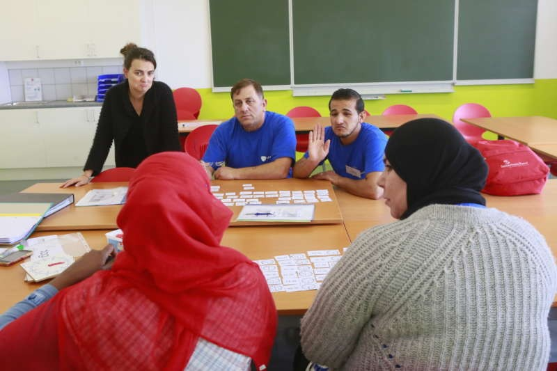 A language class for adult refugees in Mechelen. Owen Franken for The New York Times