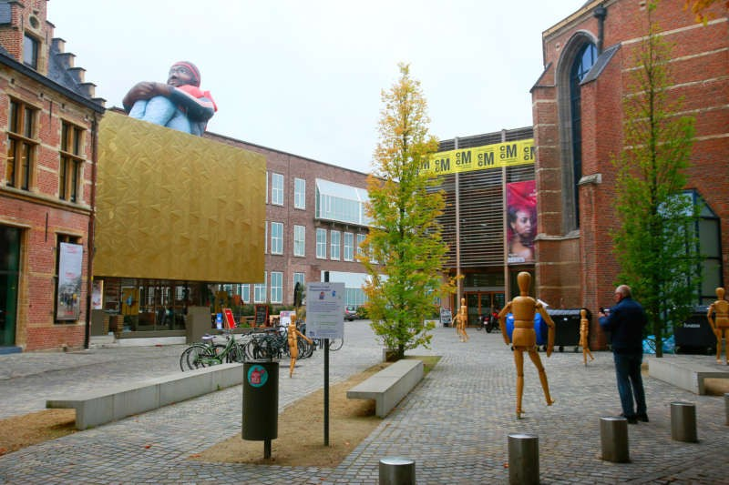 Inflatable Refugee, an installation by the artists Schellekens & Peleman, on a roof next to the Mechelen Cultural Center. Owen Franken for The New York Times