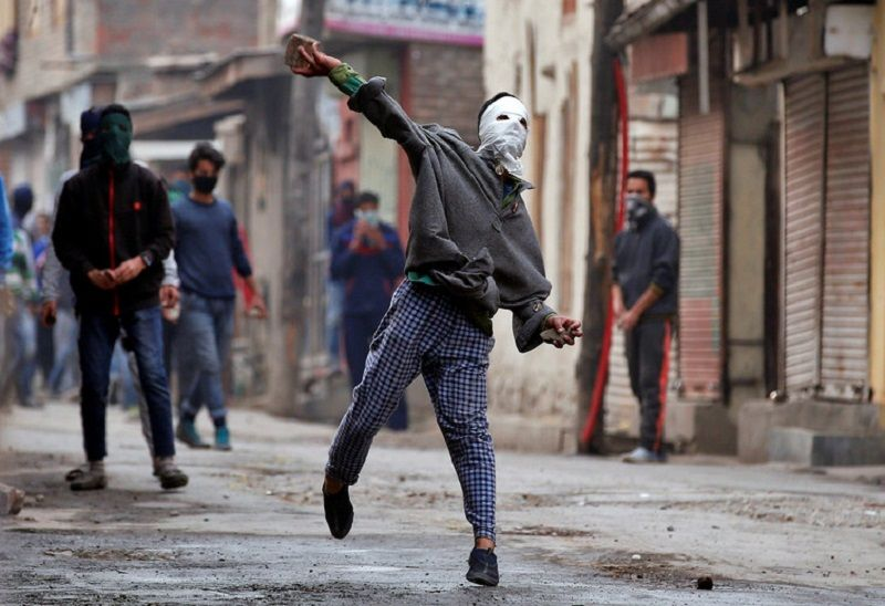 A demonstrator hurls a stone towards the Indian police during an anti-India protest in Srinagar, November 4, 2016. Danish Ismail/Reuters