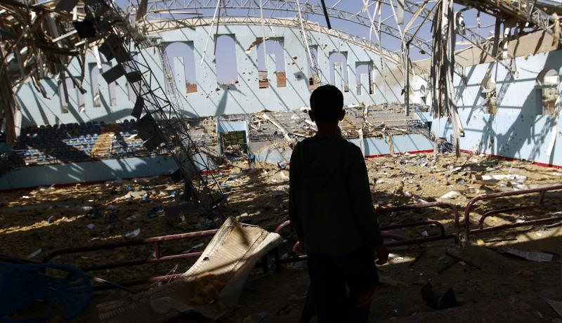 A boy inspects the damage at a sports hall in Sanaa, Yemen on January 19, 2016. Photo by Getty Images.