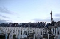 A cemetery in the rebel-held town of Douma, Syria, on the eastern outskirts of the capital city of Damascus, this month. Credit Abd Doumany/Agence France-Presse — Getty Images