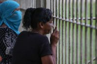 Relatives waiting on Tuesday to learn the names of those who died in a prison riot in Manaus, Brazil, over the weekend.Credit Michael Dantas/Associated Press