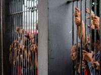 Relatives wait for news after a deadly riot at Desembargador Raimundo Vidal Pessoa Public Jail on Jan. 8 in Manaus, Brazil. (Raphael Alves/Agence France-Presse via Getty Images)