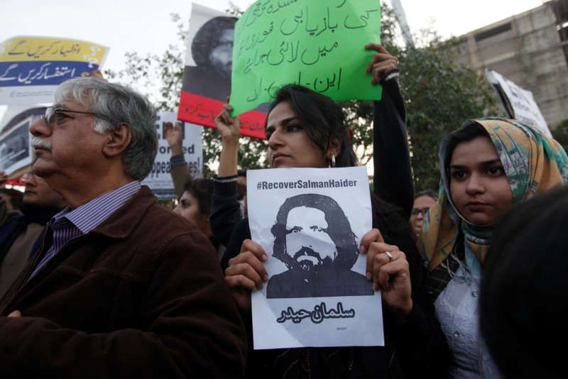 An activist holding an image of Salman Haider during a protest to condemn the disappearances of social activists, in Karachi, Pakistan, this month. Akhtar Soomro/Reuters