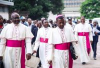 Archbishop Marcel Utembi, second from left, and other bishops arrive for the signing of an accord in Kinshasa, Congo, on Jan. 1 after talks launched by the Roman Catholic Church between the government and the opposition. (Junior D. Kannah/Agence France-Presse via Getty Images)