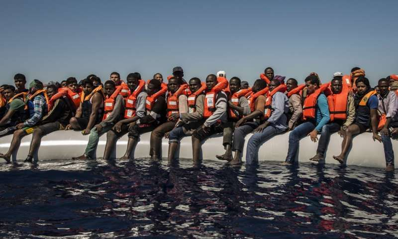 Refugees from Eritrea and other countries wait to be rescued from the Mediterranean Sea, north of Libya. Photograph: Santi Palacios/AP