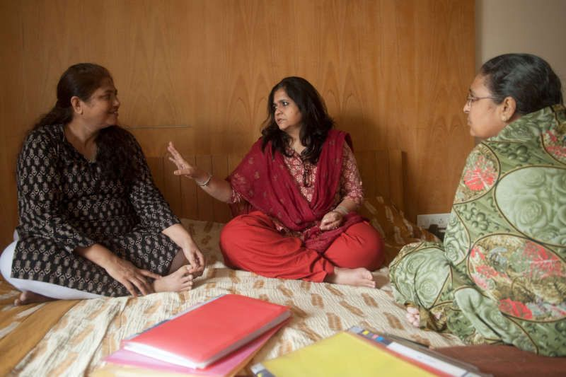 Human rights activist Teesta Setalvad, center, talks with survivors of the 2002 Gujarat riots for which she has campaigned to hold Mr. Modi criminally responsible. Manpreet Romana for The New York Times