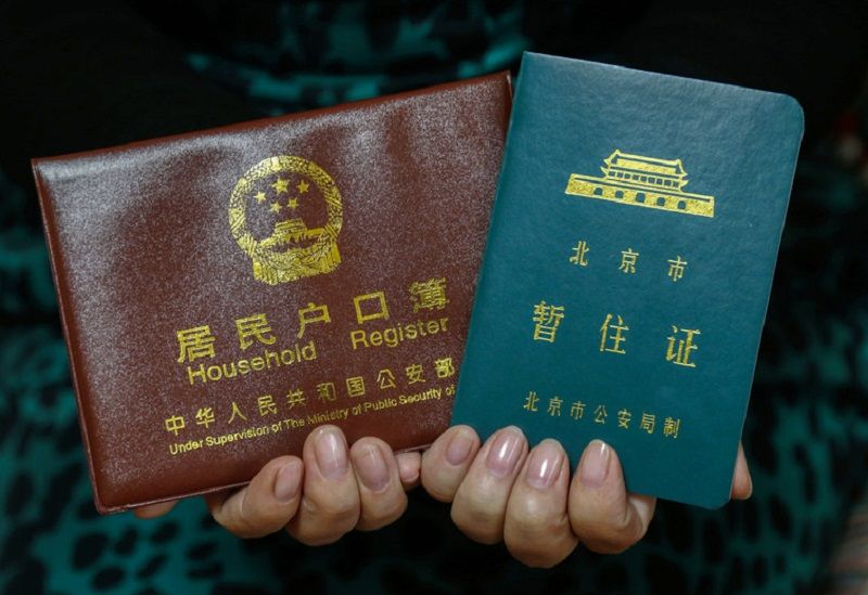 Tough choice: rural hukou (left) and Beijing temporary residence permit (right). Rolex Dela Pena/EPA