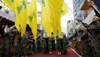 Members and supporters of Hezbollah in Beirut carry the coffins of fighters killed in combat alongside Syrian government forces in Syria. Photo by Getty Images.