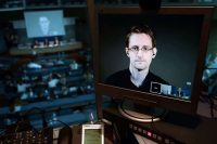 Edward Snowden seen in a live video link from Russia in 2015. Credit Frederick Florin/Agence France-Presse — Getty Images
