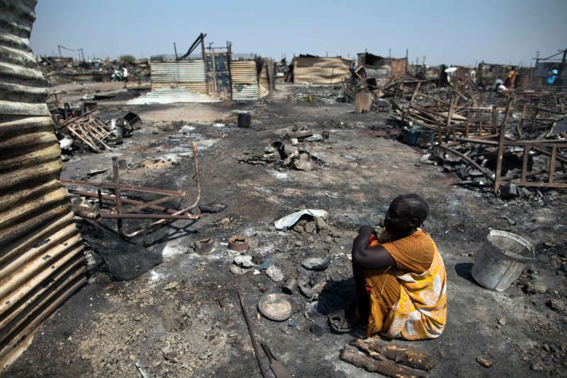 A displaced woman in the ruins of a shelter last year in Malakal, South Sudan. Albert Gonzalez Farran/Agence France-Presse — Getty Images