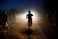 Peacekeeping troops patrol at night in the town of Abyei, disputed territory between Sudan and South Sudan, in December. Albert Gonzalez Farran/Agence France-Presse — Getty Images