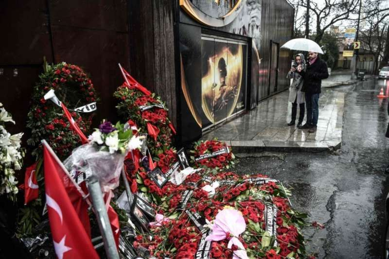 People take pictures of a makeshift memorial in front of the Reina nightclub on Jan. 5 in Istanbul, four days after a gunman killed 39 people. (Ozan Kose/Agence France-Presse via Getty Images)