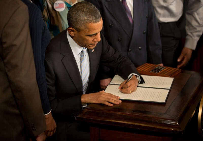 President Obama signing an executive order in February 2014 directing federal contractors to raise their minimum wage for federally funded workers. Credit Stephen Crowley/The New York Times