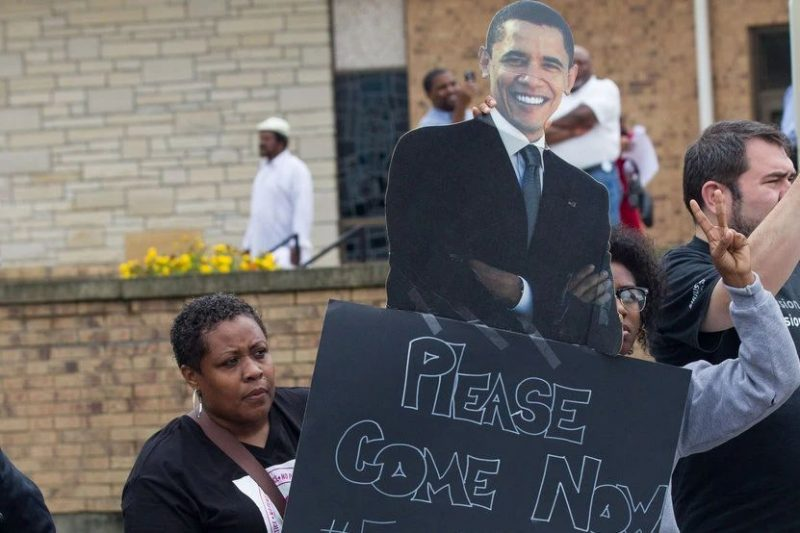 A demonstrator asking Mr. Obama to visit Missouri during the unrest there. The president instead sent his attorney general to represent the administration. Credit Whitney Curtis for The New York Times