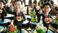 Figurines of G20 country leaders at the 2016 Hangzhou Summit. Photo via Getty Images.