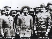 Gen. Pancho Villa, center, and Gen. John J. Pershing, right, meeting in El Paso, Tex., in 1914; two years later Pershing pursued Villa, who had led a raid on Columbus, N.M., into Mexico. Another Mexican general, Álvaro Obregón, is at left. Associated Press