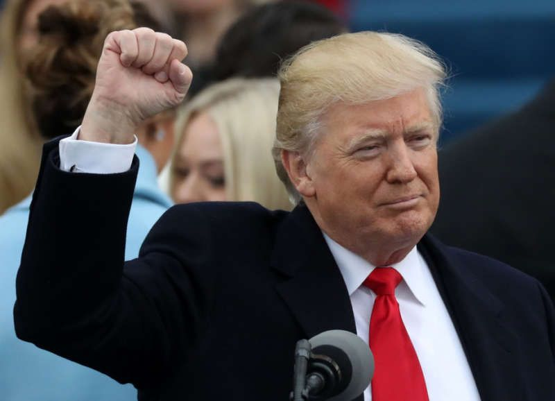 Donald Trump raises his fist after being sworn in as the 45th president of the United States Carlos Barria/Reuters