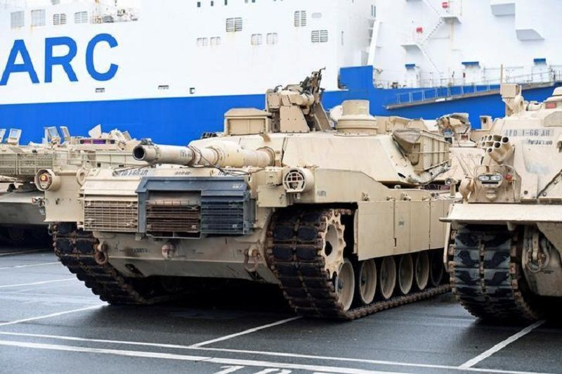 U.S. tanks, trucks and other military equipment, which arrived by ship, are unloaded in the harbour of Bremerhaven, Germany January 8, 2017. REUTERS/Fabian Bimmer