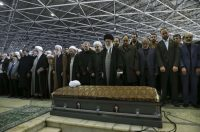 Supreme Leader Ayatollah Ali Khamenei, foreground center, leads a prayer over the coffin of former president Akbar Hashemi Rafsanjani in Tehran on Jan. 10. (Office of the Iranian Supreme Leader via AP)