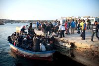 Migrants arriving from North Africa, Lampedusa, March, 2011. Giorgio Cosulich/Getty Images