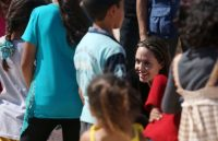 Angelina Jolie at a camp for Syrian refugees in Jordan, in September. Credit Jordan Pix/Getty Images