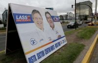 A poster with an image of Guillermo Lasso, left, presidential candidate from the CREO party, is seen beside a street in Quito, Ecuador, on Feb. 12, 2017. (Henry Romero/Reuters)