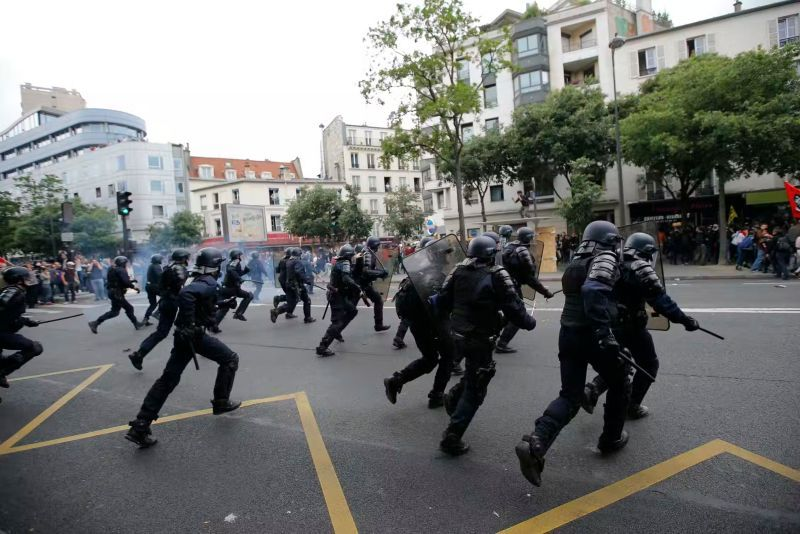 Gendarmes rush in during the 2016 labour-law protests in Paris. Stephane Mahe/Reuters