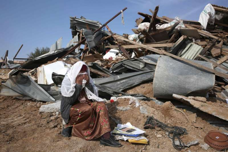 A Bedouin woman reacts to the destruction of houses by Israeli authorities on January 18, 2017 in the Bedouin village of Umm al-Hiran, which is not recognized by the Israeli government, near the southern city of Beersheba, in the Negev desert. Menahem Kahana/Agence France-Presse — Getty Images.