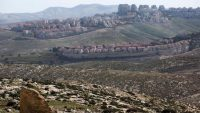 A view of the Jewish settlement of Ma'ale Adumim (foreground) and Mishor Adumim (behind), as seen from Palestinian lands in the West Bank on Feb. 7. (Jim Hollander / European Pressphoto Agency)