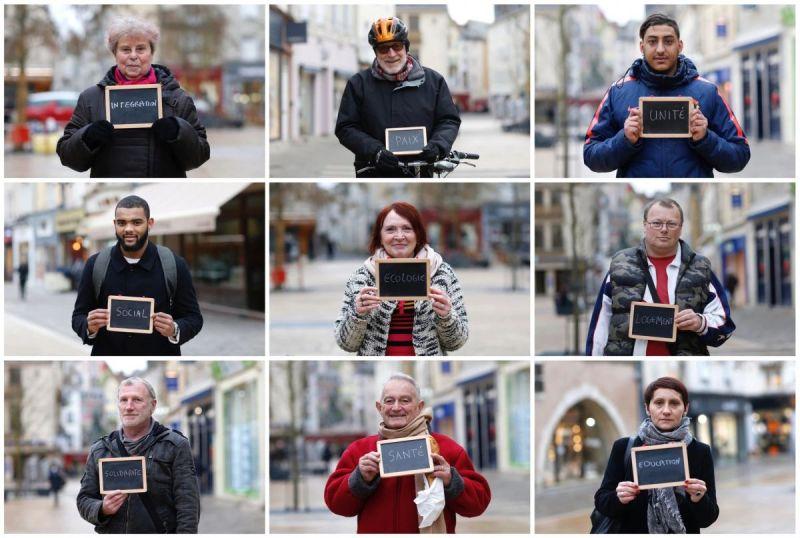Des Français à Chartres avec des tableaux indiquant leurs préoccupations principales dans l'élection présidentielle. Credit Photographs by Stephane Mahe/Reuters