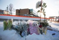 Flowers at a makeshift memorial near the Islamic Cultural Center in Quebec City, Canada. Credit Alice Chiche/Agence France-Presse — Getty Images