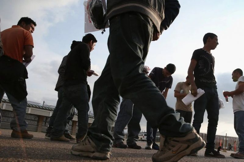 Undocumented immigrants awaited deportation last April at the U.S.-Mexico border in Hidalgo, Tex. Guidelines for President Trump's immigration crackdown say deportees will be returned to the contiguous country from which they entered the United States — even if they are not citizens of that country. Credit John Moore/Getty Images