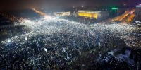 General view of Victoriei Plaza full of protesters flashing the lanterns on their cell-phones, all at the time, during a massive protest in front of government headquarters, background, in Bucharest, Romania, 05 February 2017